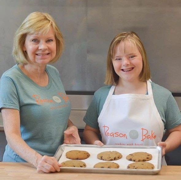 mom and down syndrome daughter make cookies together