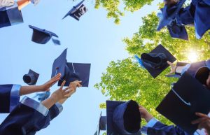a letter to graduates caps in the sky