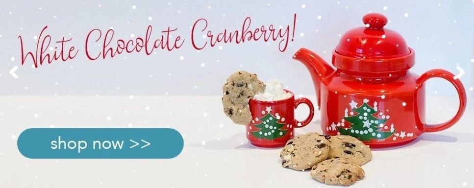 red tea pot and matching tea cup with chocolate chip cookies and snowflakes