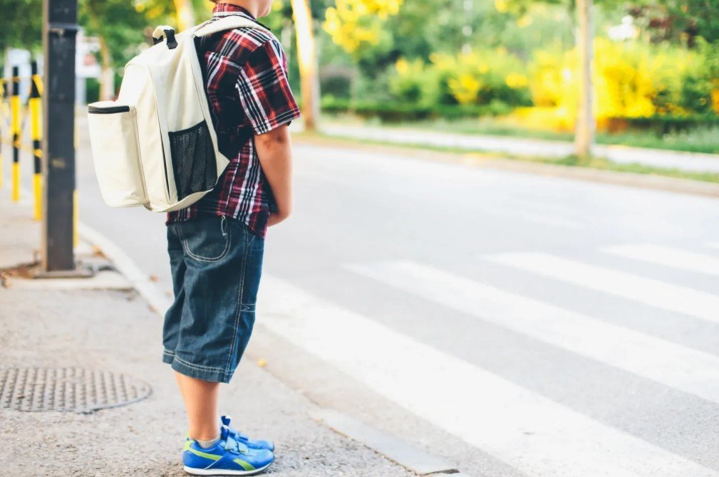 is my child going to fall behind in school | boy waits for the school bus