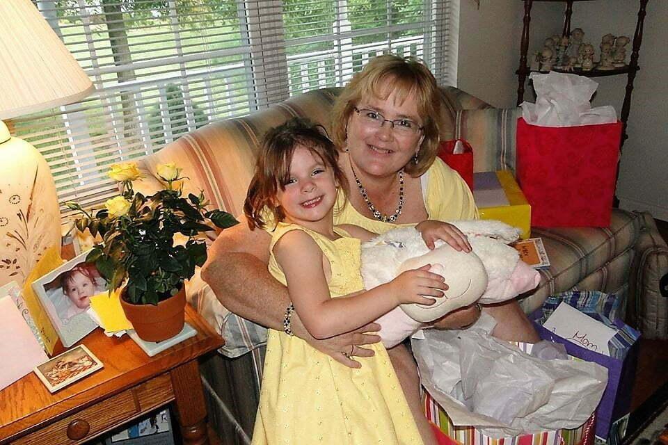 grandma and granddaughter dressed in yellow smiling at the camera