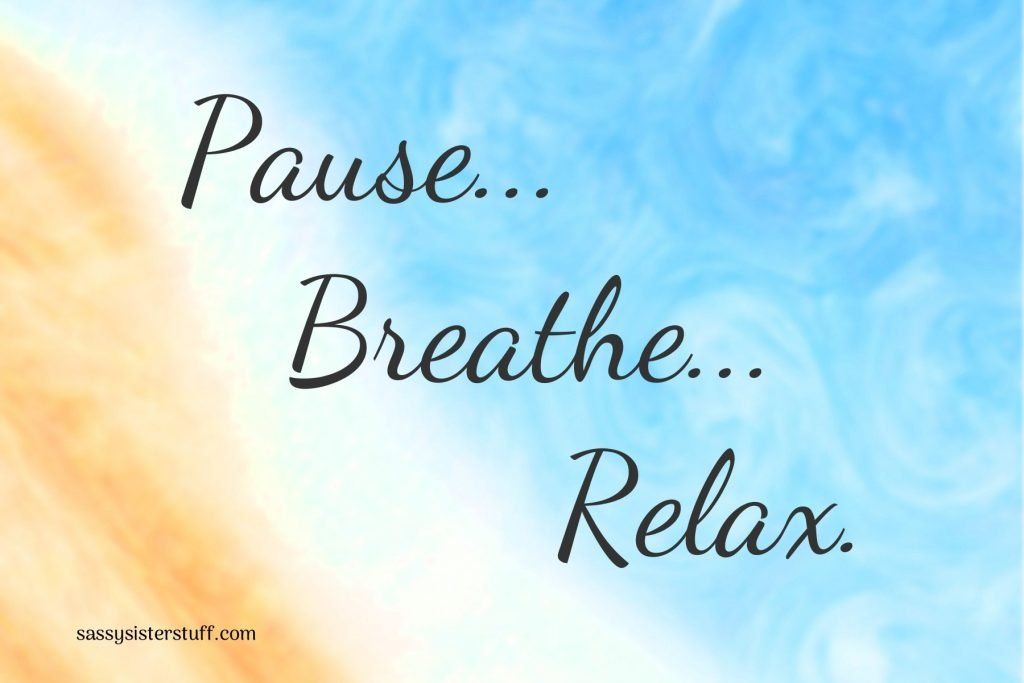 pause, breathe, relax on a swirly blue and orange background