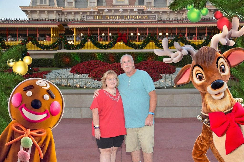 man and woman standing in front of Magic Kingdom at Disney World at Christmas time