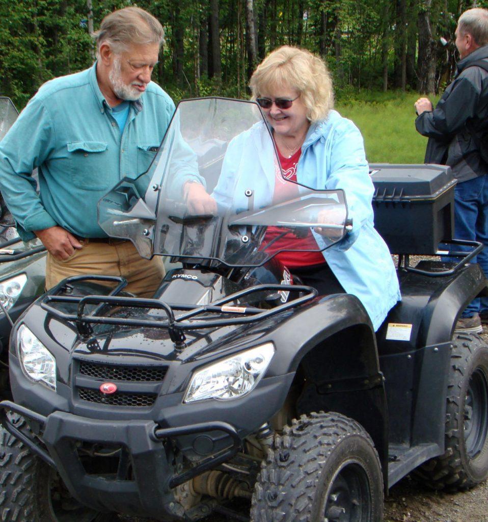 woman on ATV ready to ride into alaska wilderness