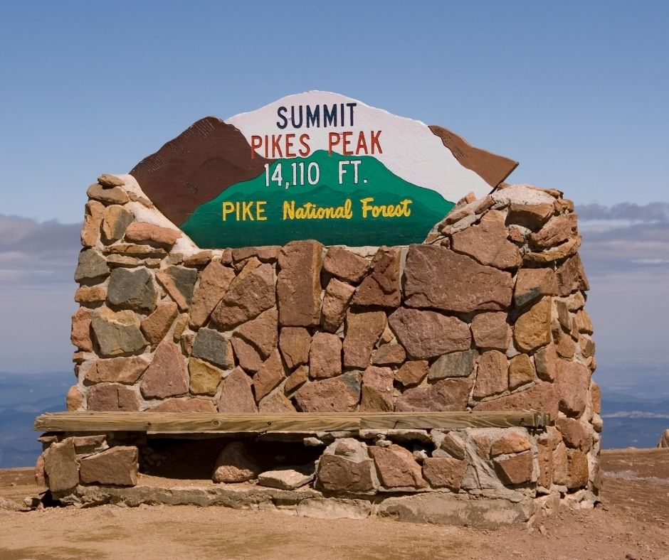 pikes peak summit sign at pike national forest