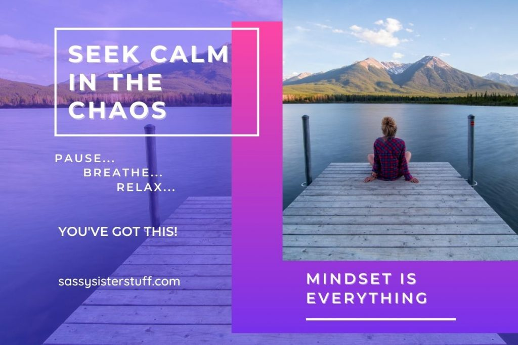 woman sitting on a pier looking over a lake with mountains in the background and a quote about calm in the chaos