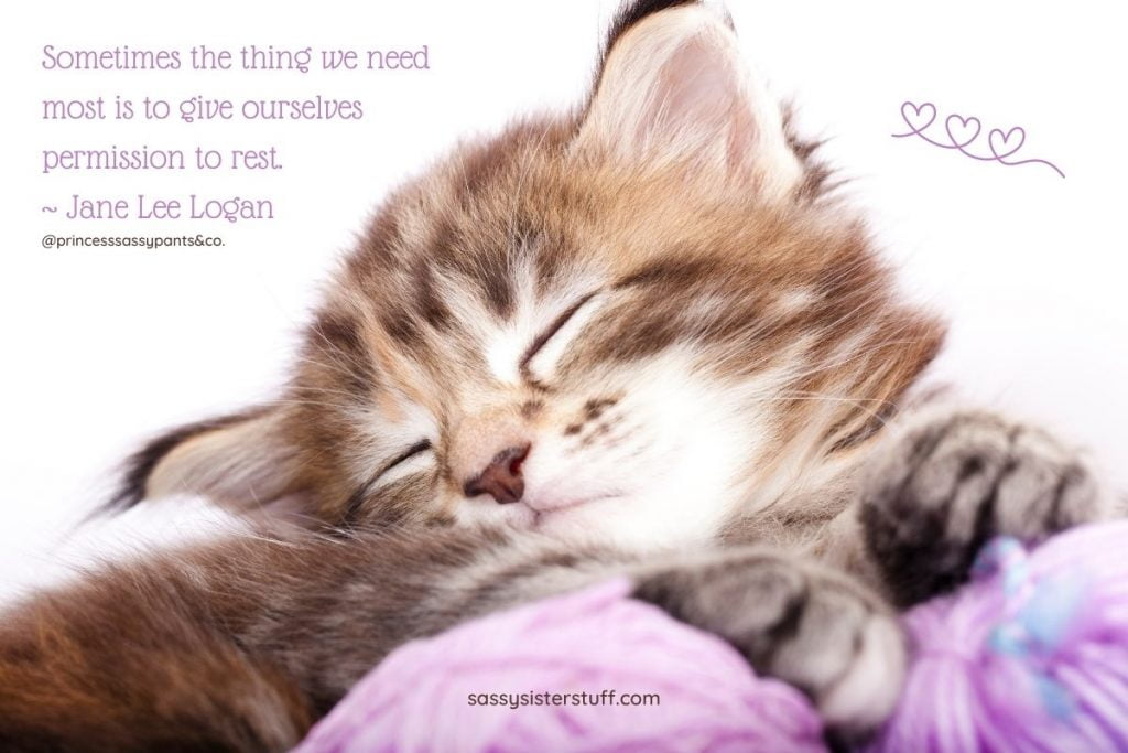 brown tabby kitten sleeping on a purple blanket with a quote about giving yourself permission to rest