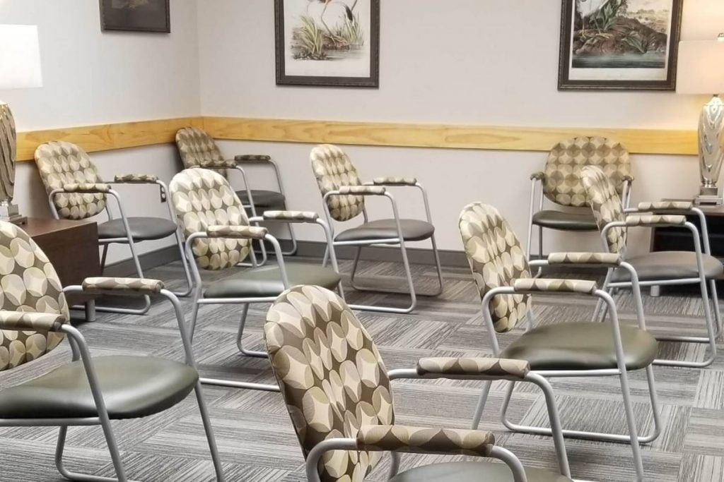 chairs spread out in the waiting room of a doctors office during the pandemic