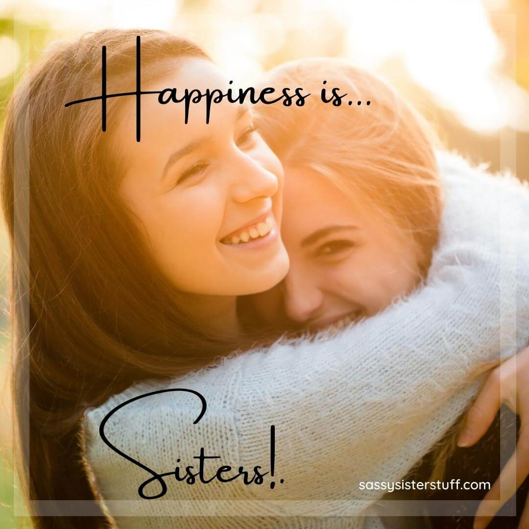two sisters hug each other smiling and words that say happiness is sisters
