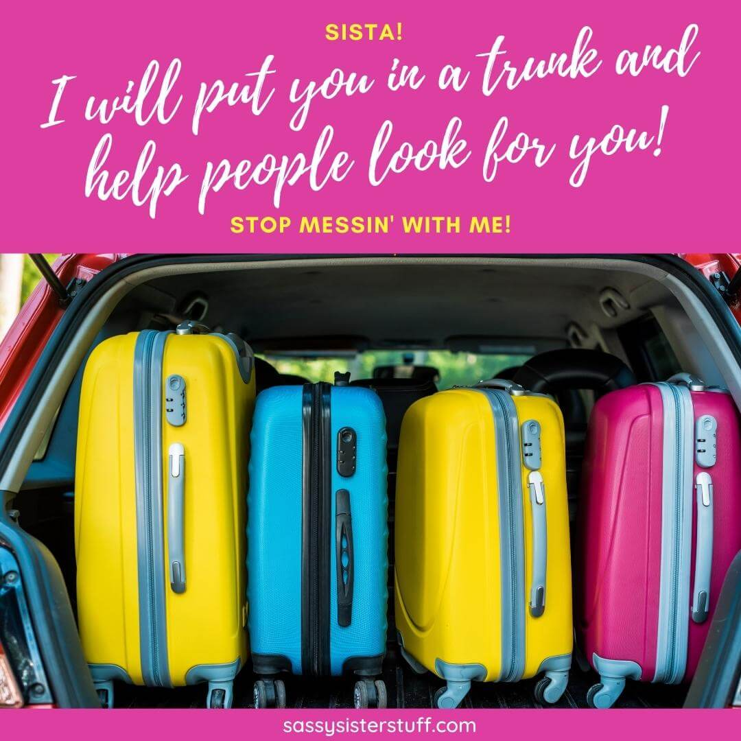brightly colored luggage in a car trunk with a sassy sister quote