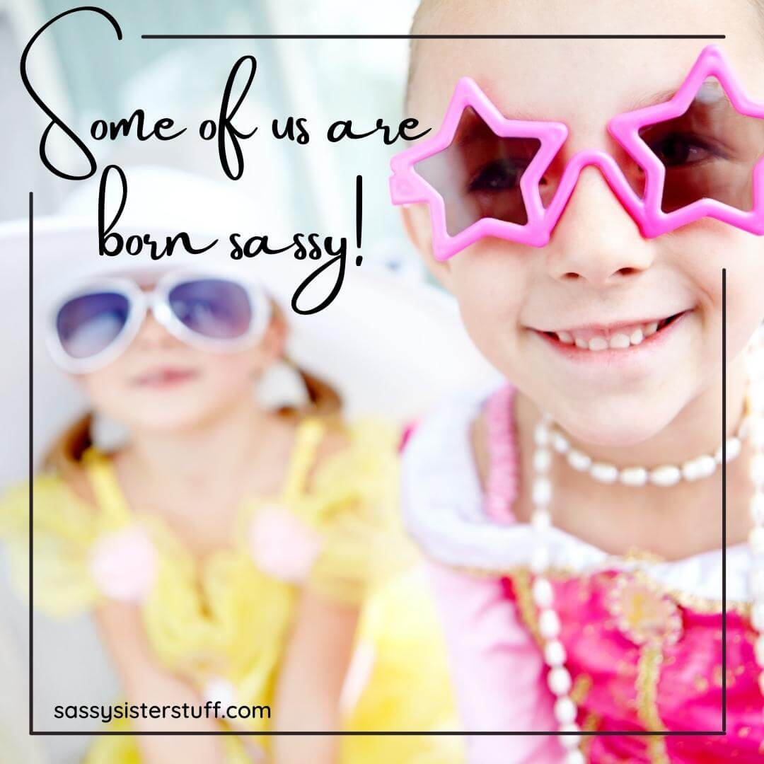 two little girls wearing big plastic colorful glasses and a funny girl quote