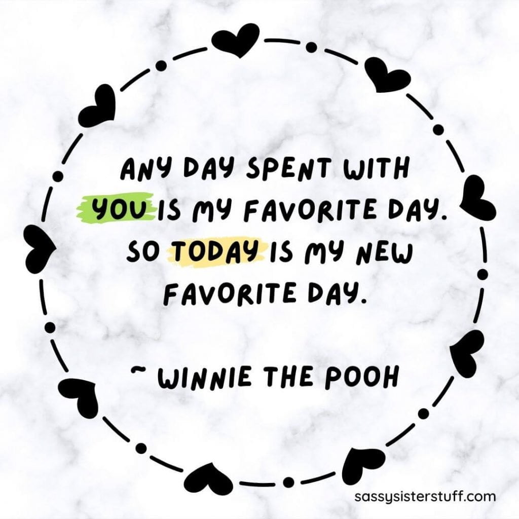 black and white marble background with heart circle in the center and a quote from winnie the pooh