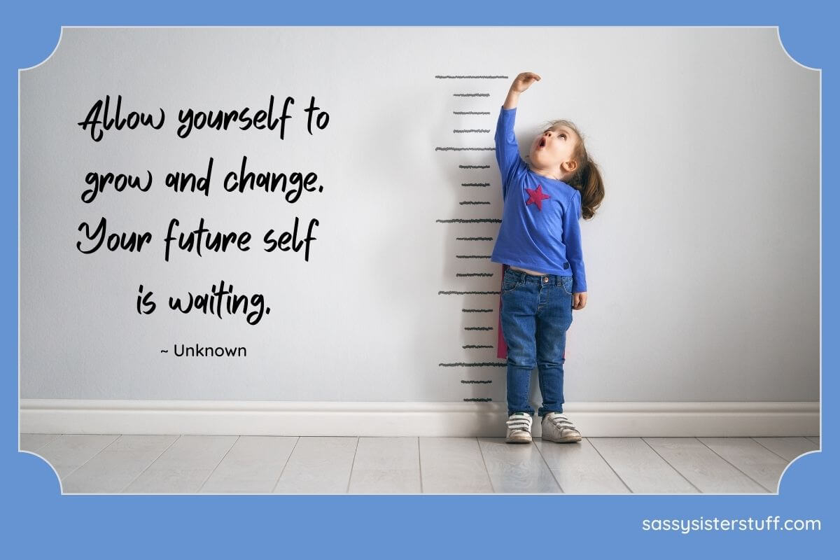 little girl measuring how tall she is against a wall with an excited look of joy on her face and a quote about personal growth