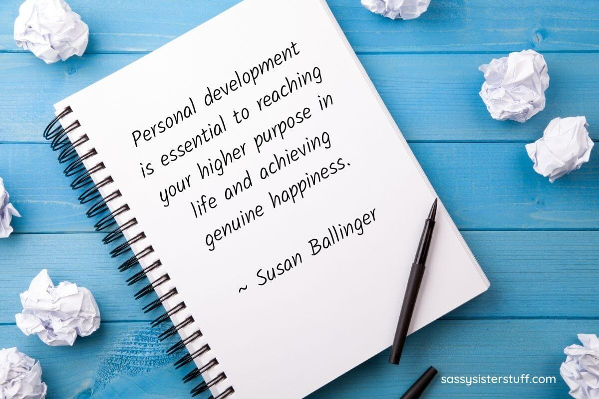 personal development quote about higher purpose and happiness written in a notebook