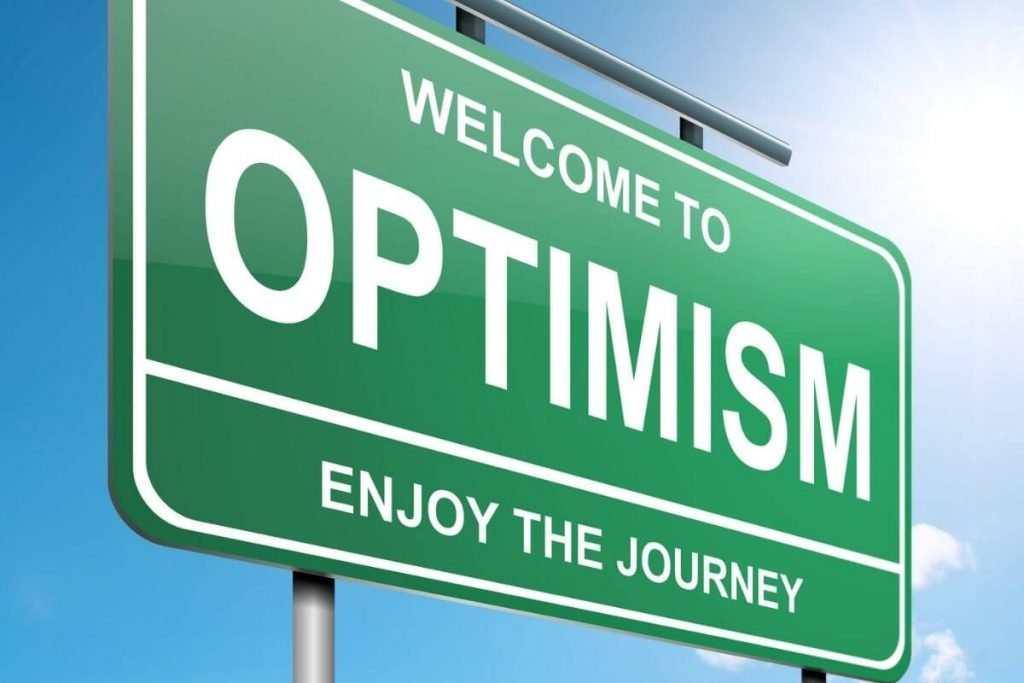 a highway sign that says welcome to optimism