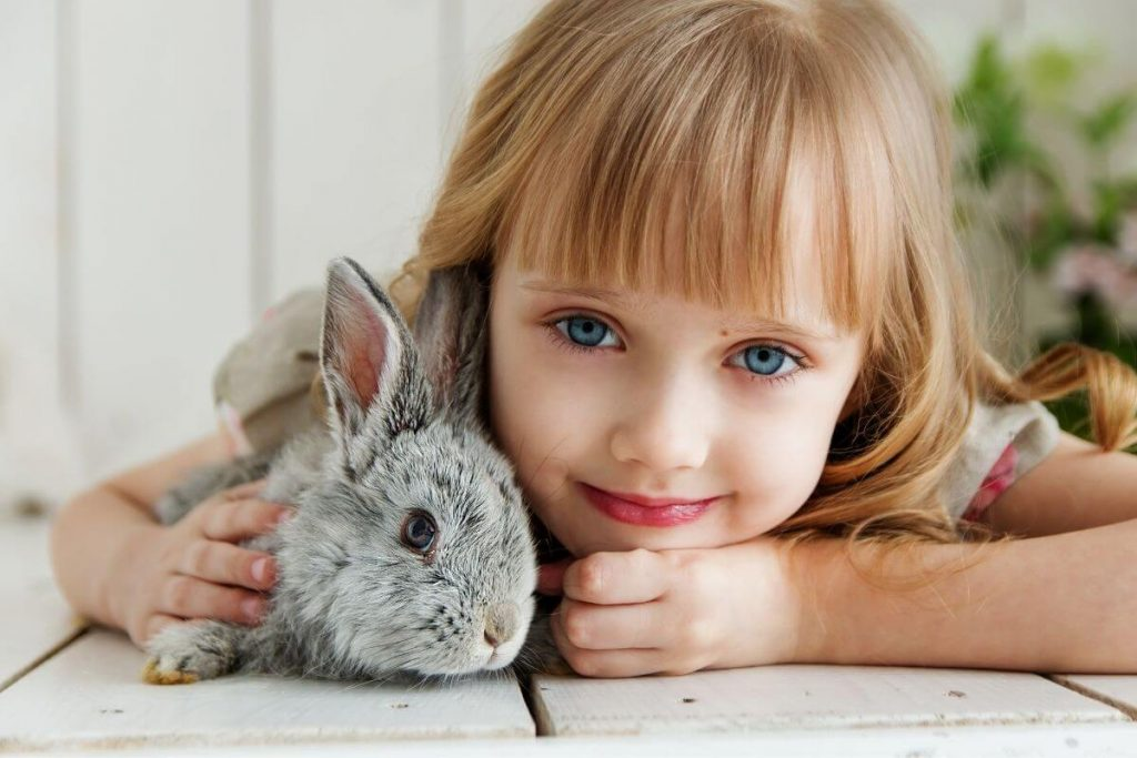 little girl hugging her pet bunny