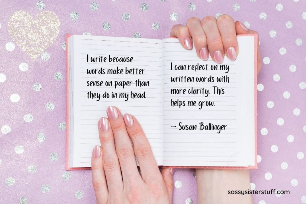 pink background with silver dots and a woman's hands holding an open journal with a quote about journaling