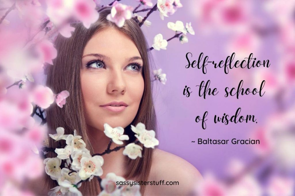 beautiful woman standing among cherry blossoms self reflecting with a self reflection quote