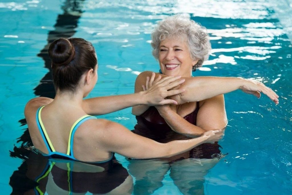 two women work out in the pool to stay healthy