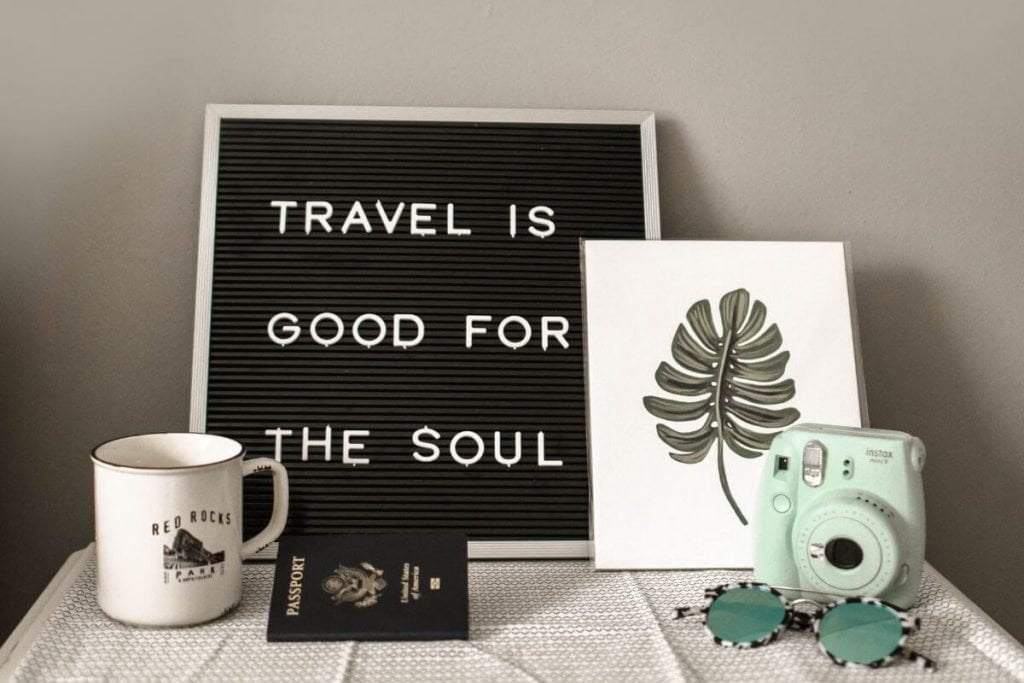 a display on a table that says travel is good for the soul