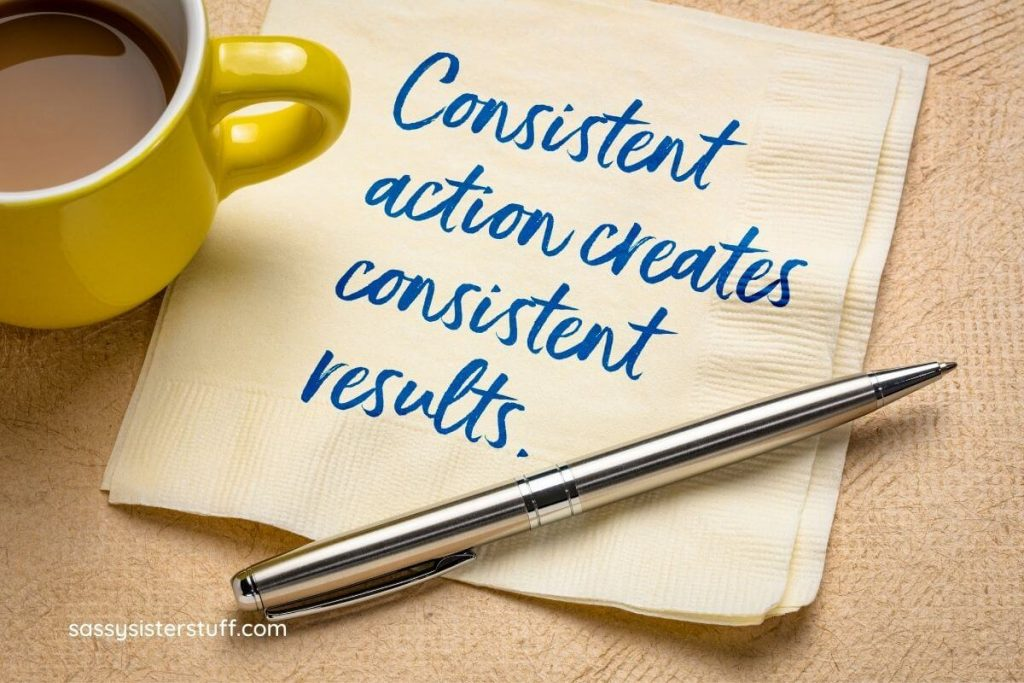 consistent action creates consistent results written on a napkin sitting next to a cup of coffee