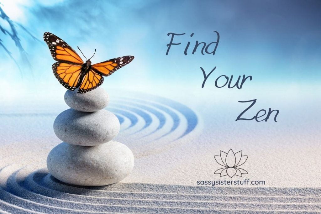 three white stones stacked on white sand with a yellow butterfly on top and find your zen written next to the image