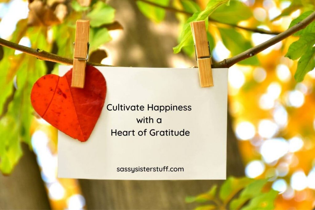 note hanging on a tree that says cultivate happiness with a heart of gratitude