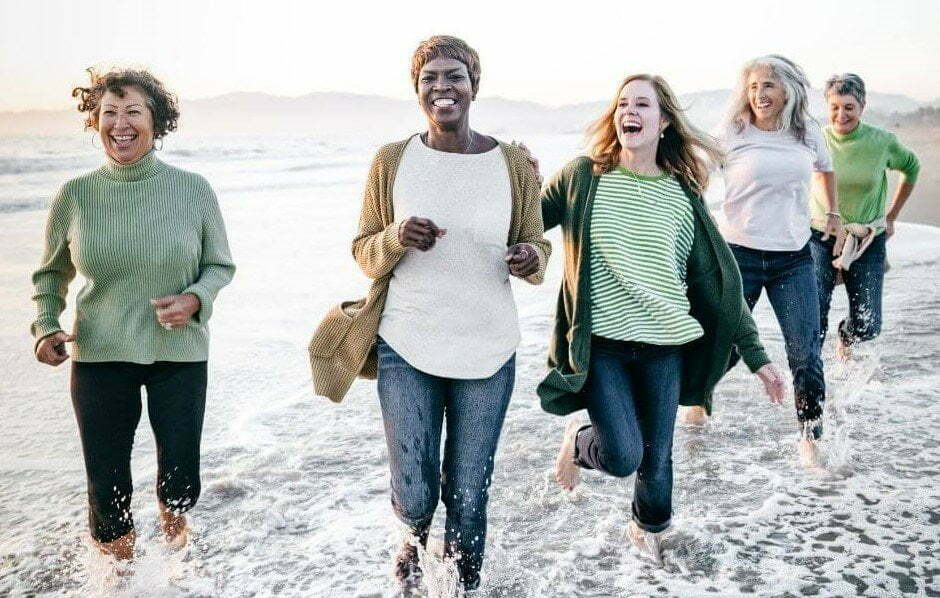 Sassy Sister Stuff Home Page image of happy ladies running along the beach