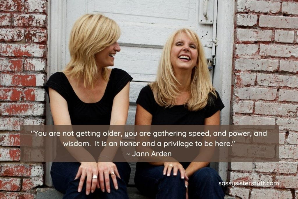 daily wellness tips for midlife with two happy middle aged women sitting on a stoop together