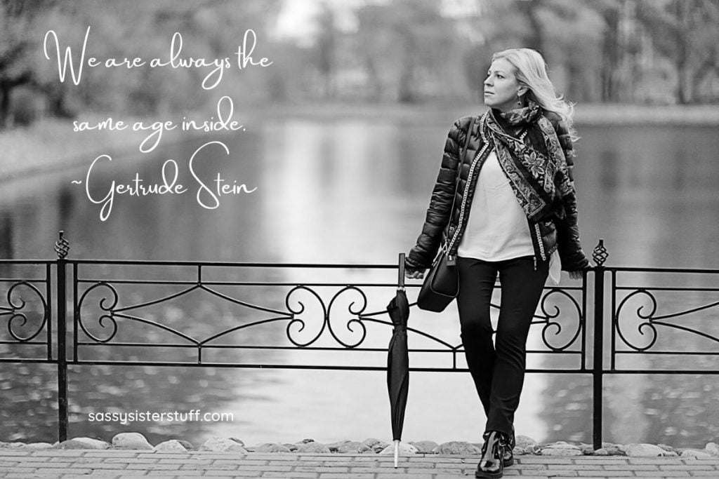 middle aged woman leaning against a fence with a quote about aging