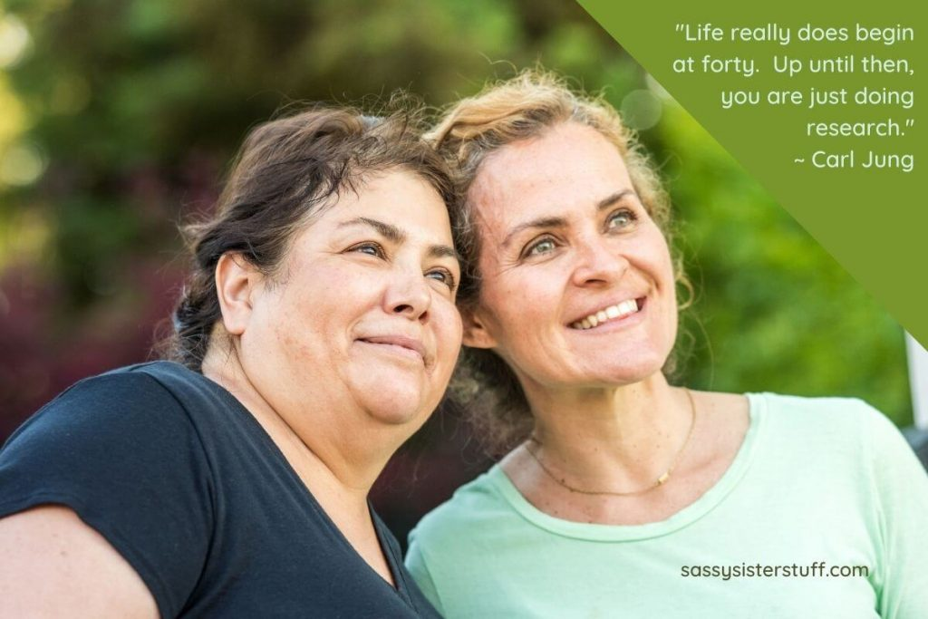 two happy middle aged women and a quote about midlife