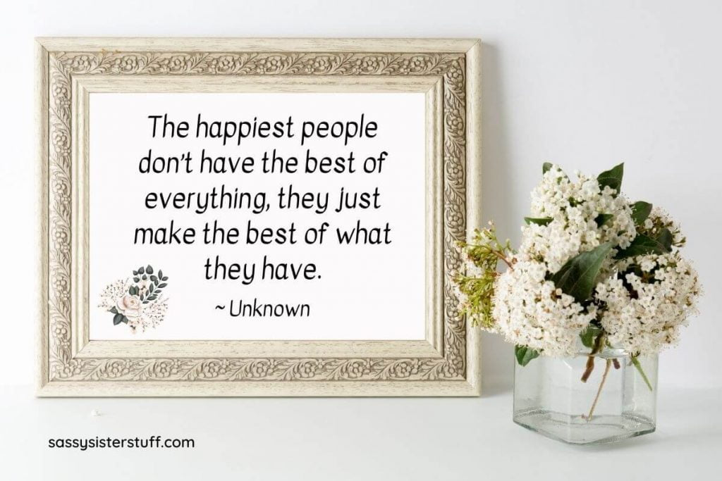 beautiful white flowers and a framed quote about how to be happy